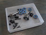 Tray of machine parts that can be tracked with RFID using InformaTrac Pro